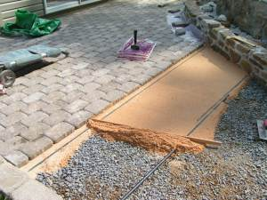 Leveling the sand for the pavers
